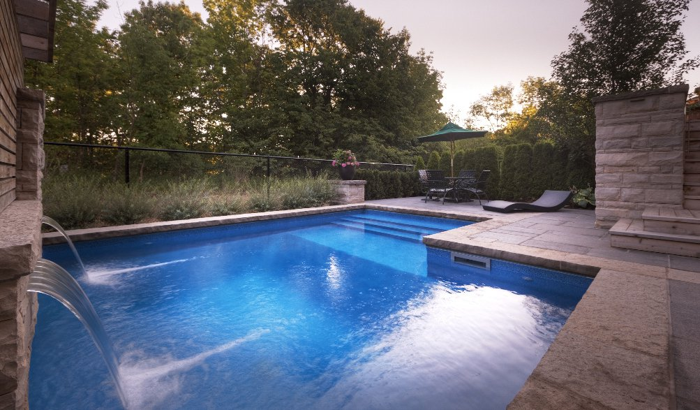 Contemporary pool design & natural stone patio on bronte creek